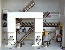 Two motors traveling on linear guides for end-trimming